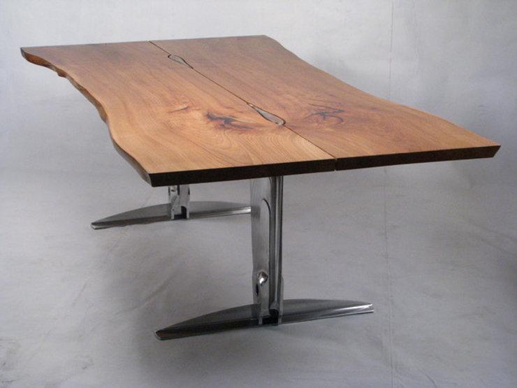Red and chrome table titled Jet Ranger Dining Table  by aviation furniture designer arnt arntzen