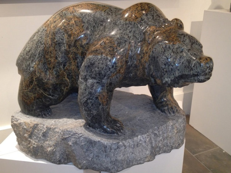 """serpentine stone sculpture titled SOLD 'Walking Bear """"The Chieftain"""" by sculptor cathryn jenkins."""