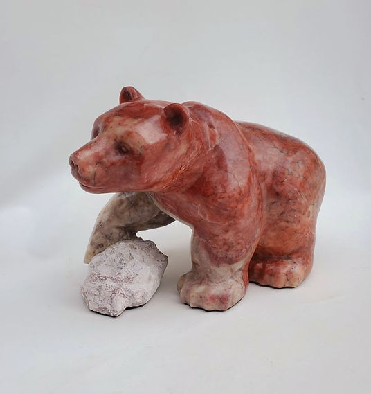 red alabaster soapstone scupture titled SOLD - Oh Canada by sculptor roy hinz.
