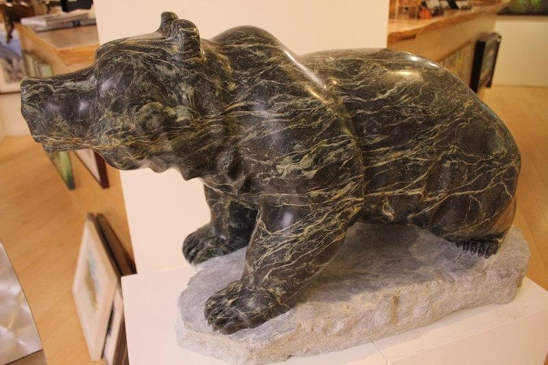 serpentine stone sculpture titled SOLD-Wonder Bear by sculptor cathryn jenkins.