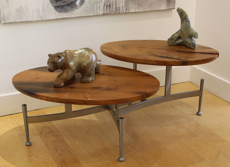 Coffee and chrome table titled Lilly Pad coffee table  by aviation furniture designer arnt arntzen