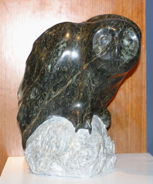 serpentine stone sculpture titled SOLD: Owl  by sculptor cathryn jenkins.