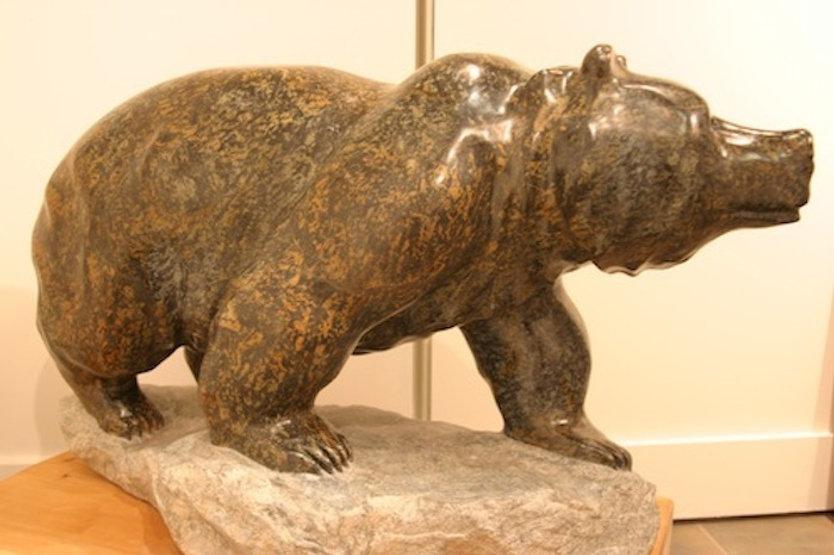"serpentine stone sculpture titled SOLD- Walking Bear ""Proud Warrior"" by sculptor cathryn jenkins."