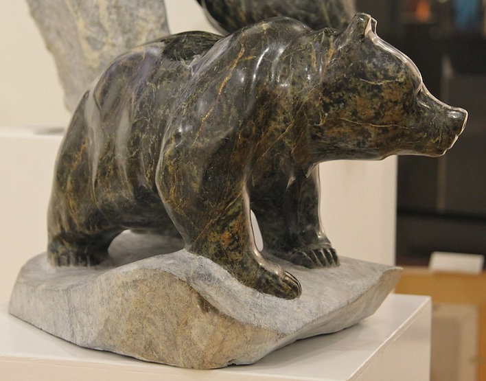 serpentine stone sculpture titled SOLD - Running Bear by sculptor cathryn jenkins.