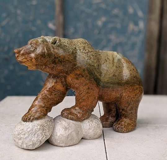 soapstone sculptor titled Spring Bear by sculptor andrew gable.