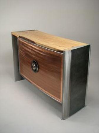 Red and chrome desk titled Heli Bar by aviation furniture designer arnt arntzen