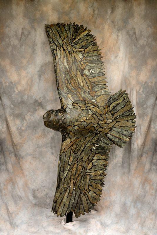 serpentine stone sculpture titled Owl in Flight by sculptor cathryn jenkins.