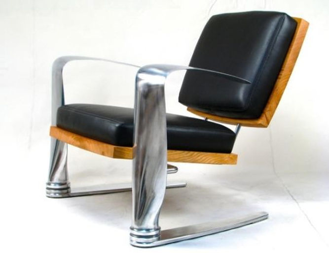 Red and chrome chair titled Pilot Chair by aviation furniture designer arnt arntzen