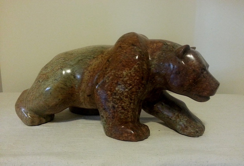 soapstone scupture titled SOLD - Kelowna by sculptor roy hinz.