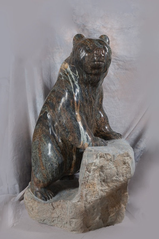 serpentine stone sculpture titled SOLD-Candy Bear by sculptor cathryn jenkins.