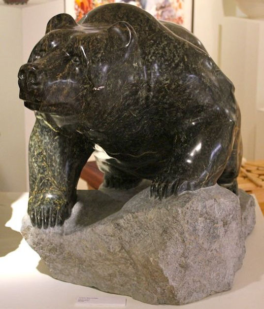 serpentine stone sculpture titled SOLD-Crouching Bear by sculptor cathryn jenkins.
