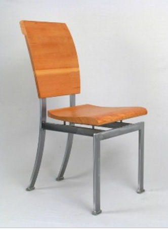 Red and chrome chair titled Church chair by aviation furniture designer arnt arntzen