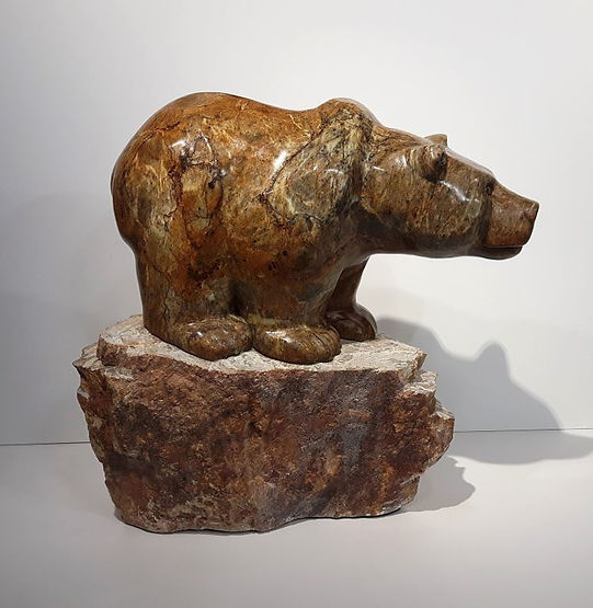 soapstone scupture titled SOLD-The Lookout by sculptor roy hinz.