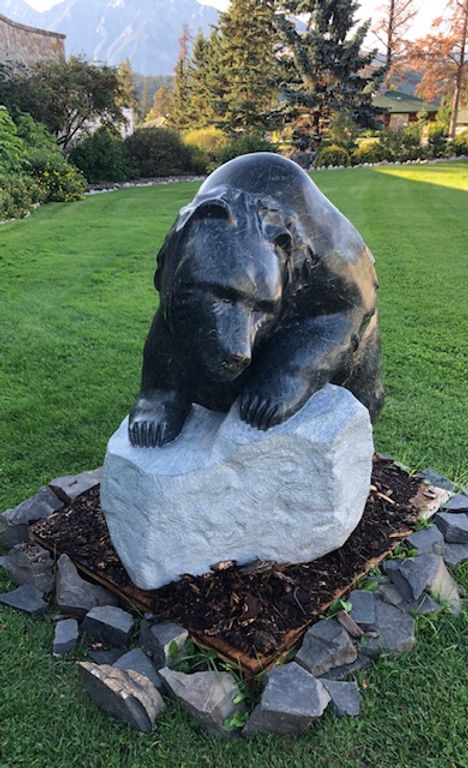 serpentine stone sculpture titled Large Climbing Bear by sculptor cathryn jenkins.