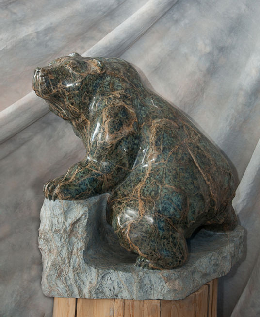 serpentine stone sculpture titled SOLD-Rough Terrain Grizz by sculptor cathryn jenkins.