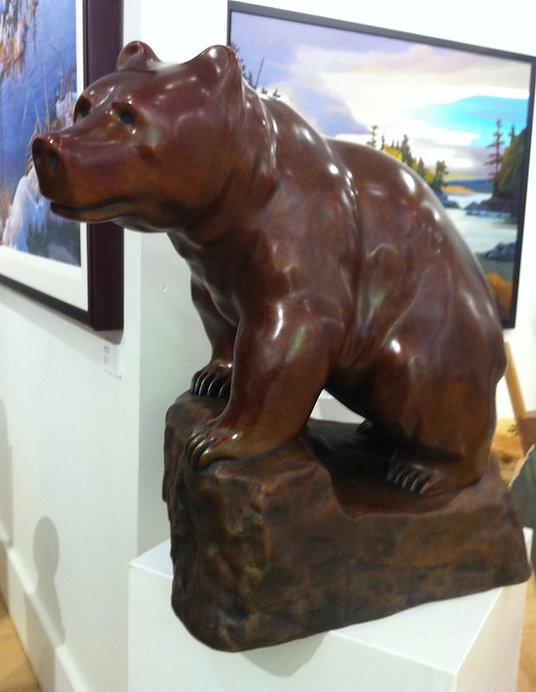 bronze sculpture titled Cinnamon Bear by sculptor cathryn jenkins.
