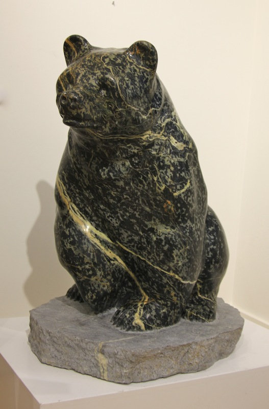 serpentine stone sculpture titled SOLD- Sitting Bear by sculptor cathryn jenkins.
