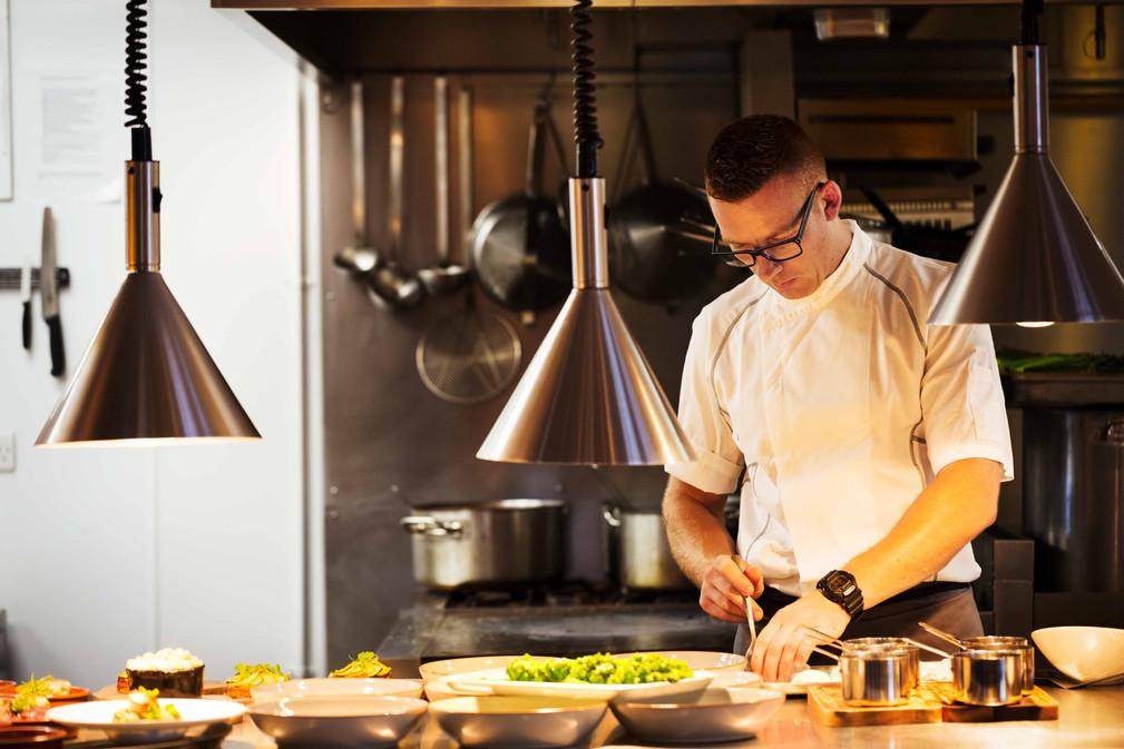 chef-standing-in-a-restaurant-kitchen-pl