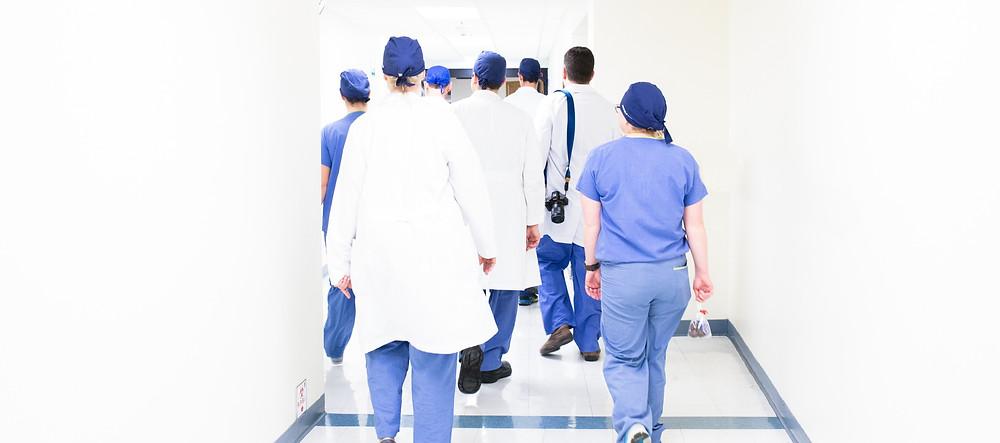 Hospital staff walking down corridor
