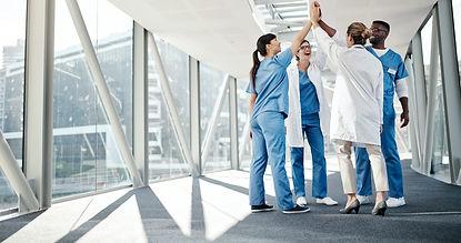 compressed- happy doctors high five