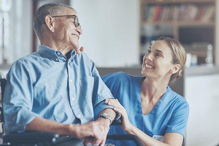happy man talking to nurse