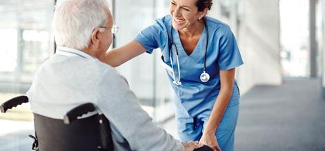 Happy Nurse talks to patient