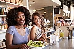 two-women-enjoying-lunch-date-in-delicat
