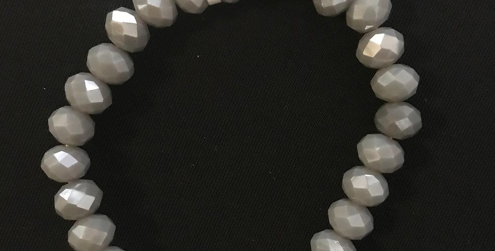 Bracelet élastic gris avec strass noir rond