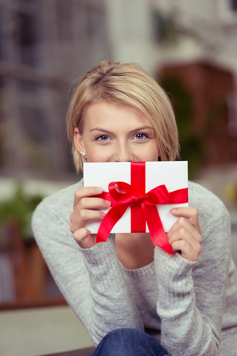 Young woman holding a decorative gift ti
