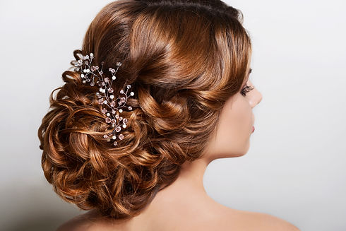 hairstyle with ornaments curls collected