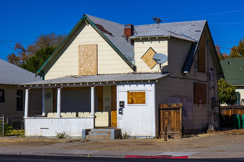Old Boarded Up Home Lost To Foreclosure.