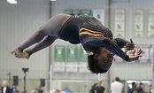 Women's artistic gymnast mid back flip