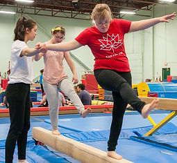 Adaptive athletes on balance beam