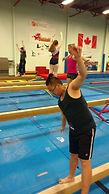 Adult athletes on balance beam