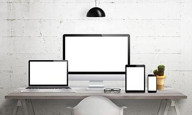 ein pc, ein laptop und ein tablet