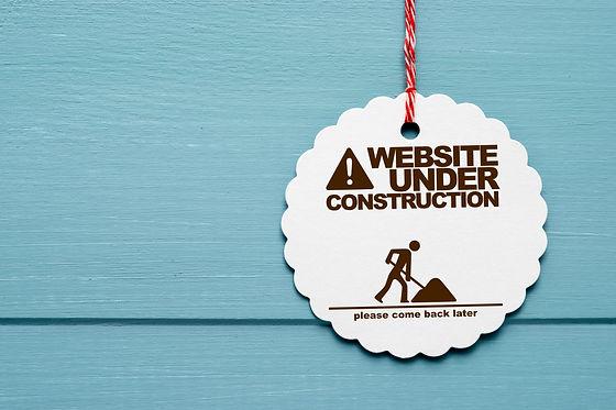 website under construction schild
