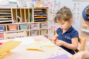 Child learning scissors use.jpg