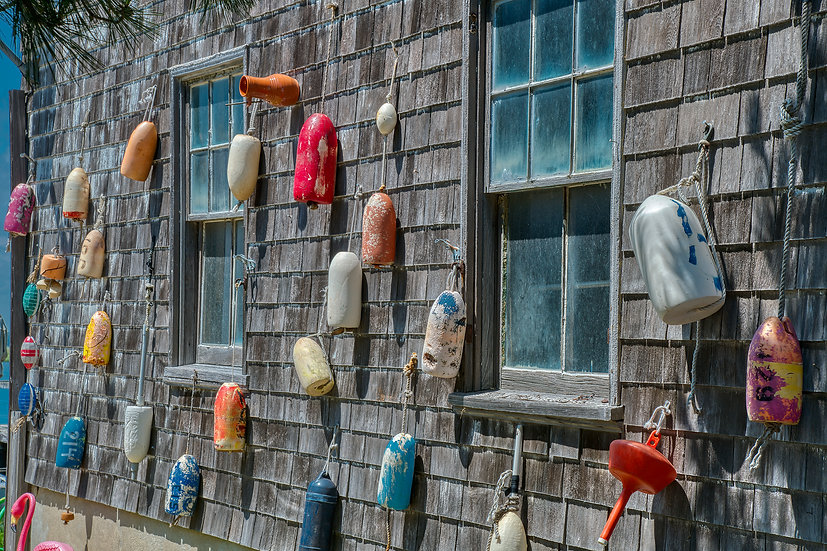 BUOYS ON THE BOAT HOUSE WALL img#100913