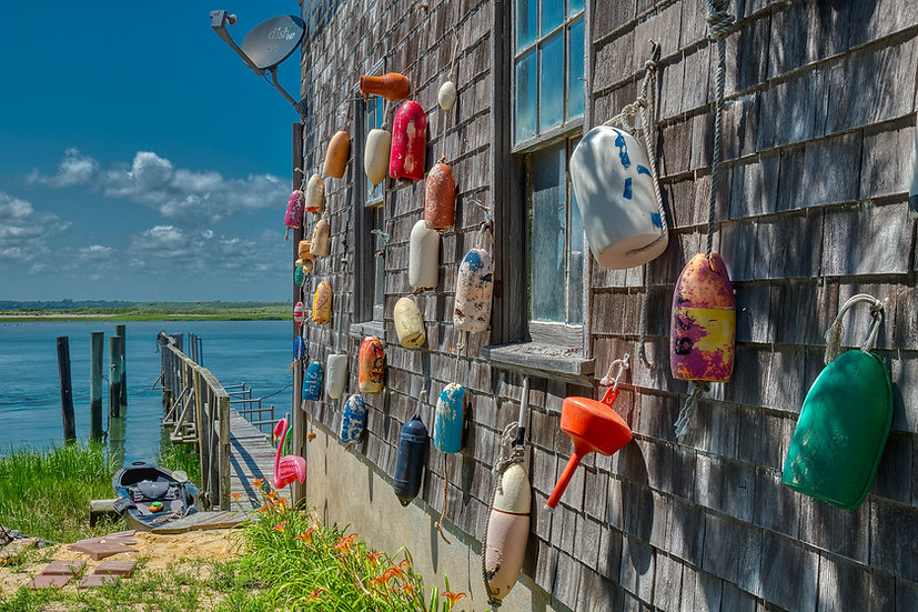 OLD BOAT HOUSE AND BUOYS ON THE BAY img#100910