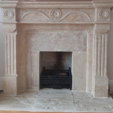 Marble surround with stone open fireplac