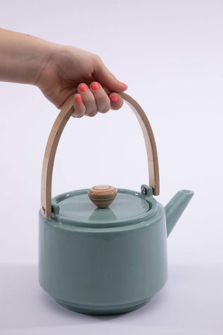 Blue teapot, featuring a hand turned knob and hand laminated handle
