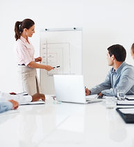 Consulting- meeting, woman at whiteboard