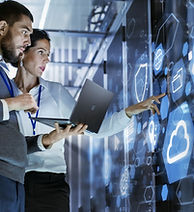 man and woman looking at IT screen .jpg