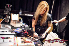 Lita Ford signing autographs for fans