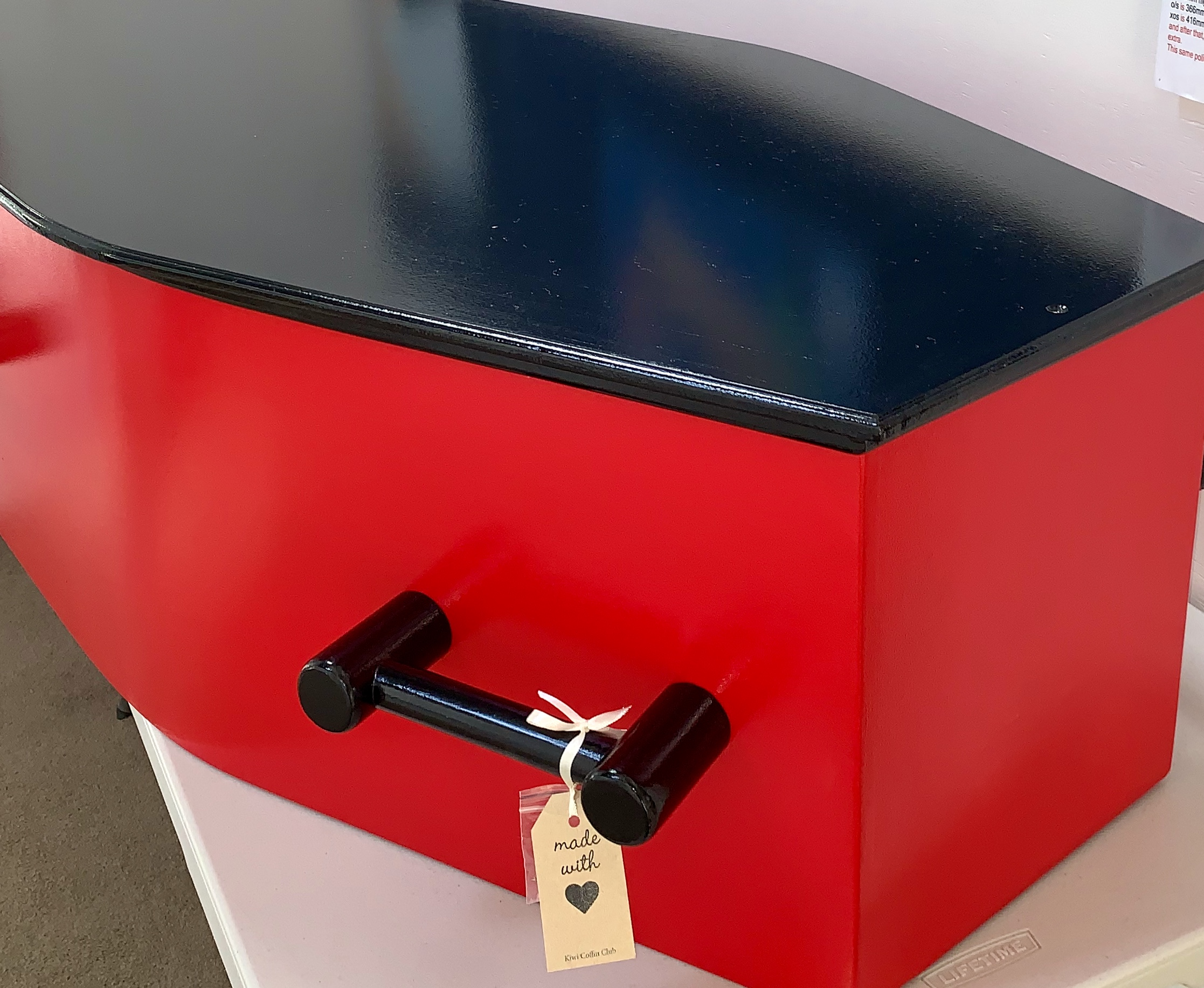 red coffin with black lid