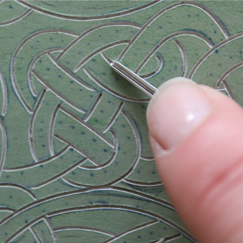 Carving the Sutton Hoo gold belt buckle into the lino bloc