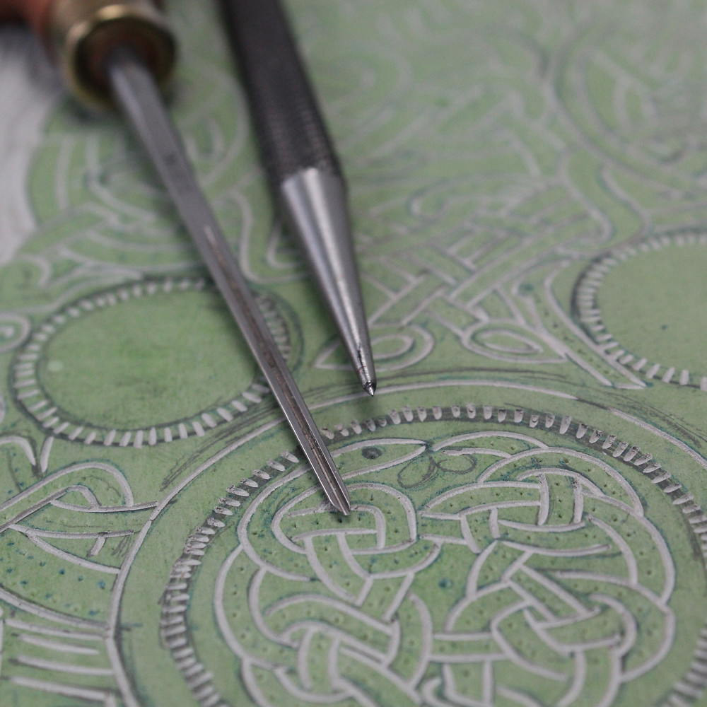 Close up detail of the carved linocut block of the Sutton Hoo Anglo-Saxon gold belt buckle.