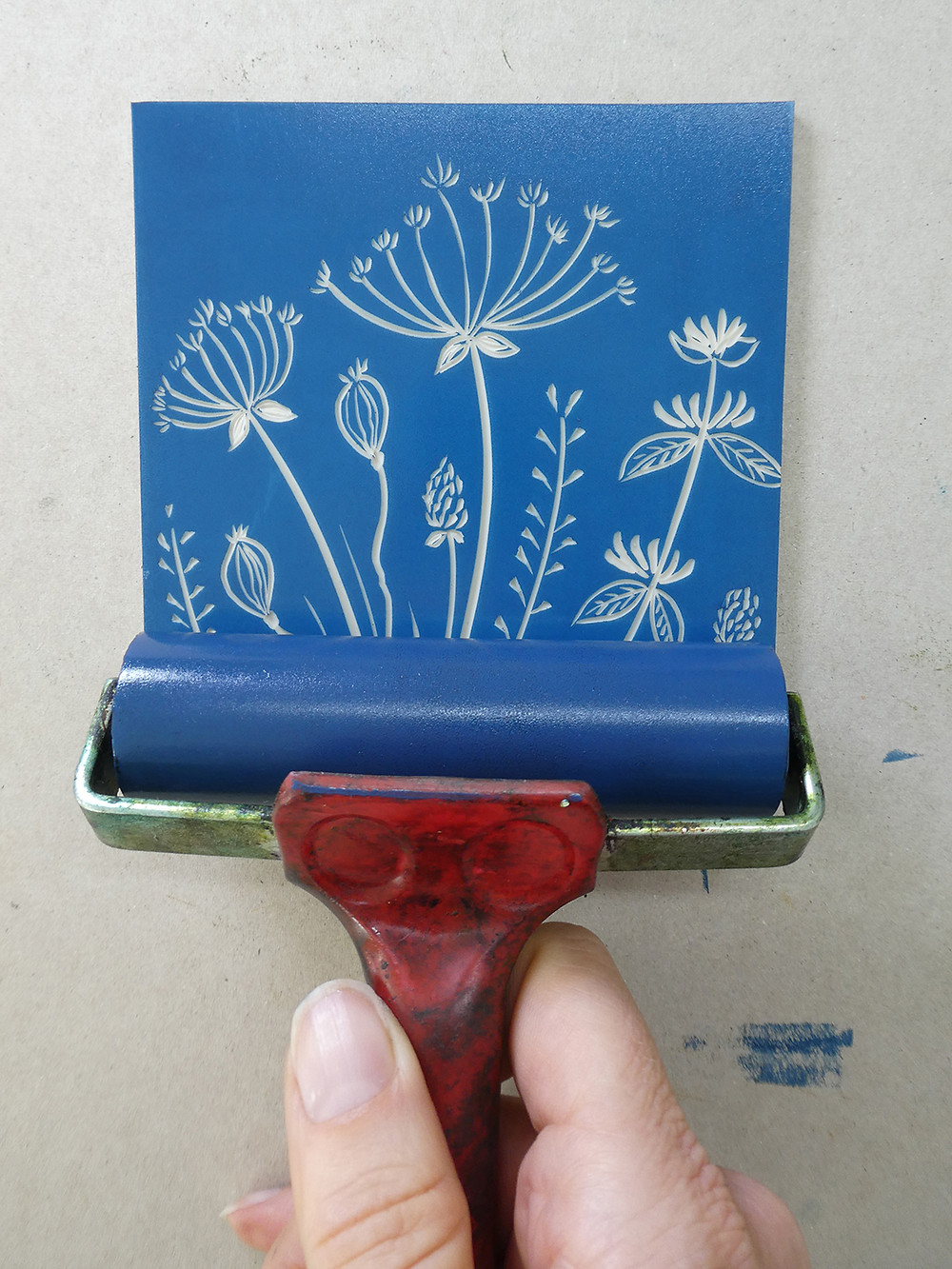 Rolling ink onto the lino block using water based inks