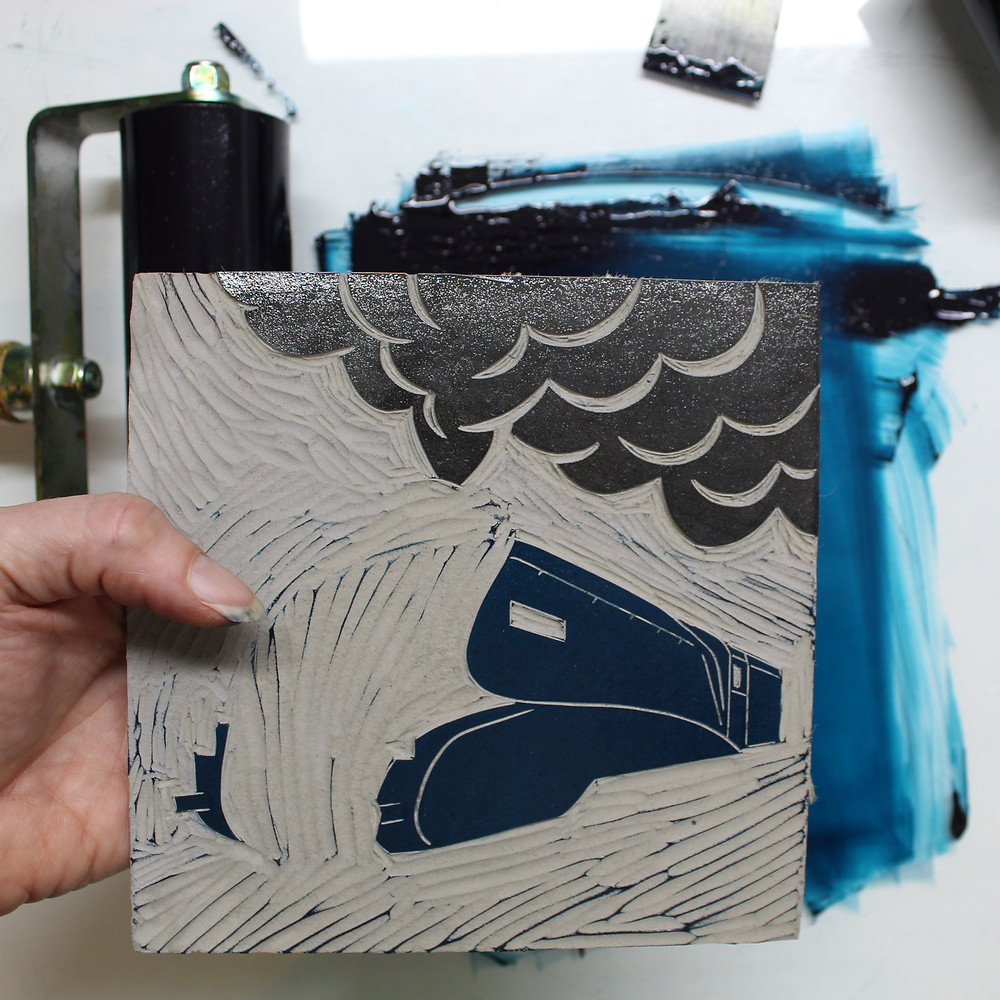 Inking the lino block with blue and grey oil based inks