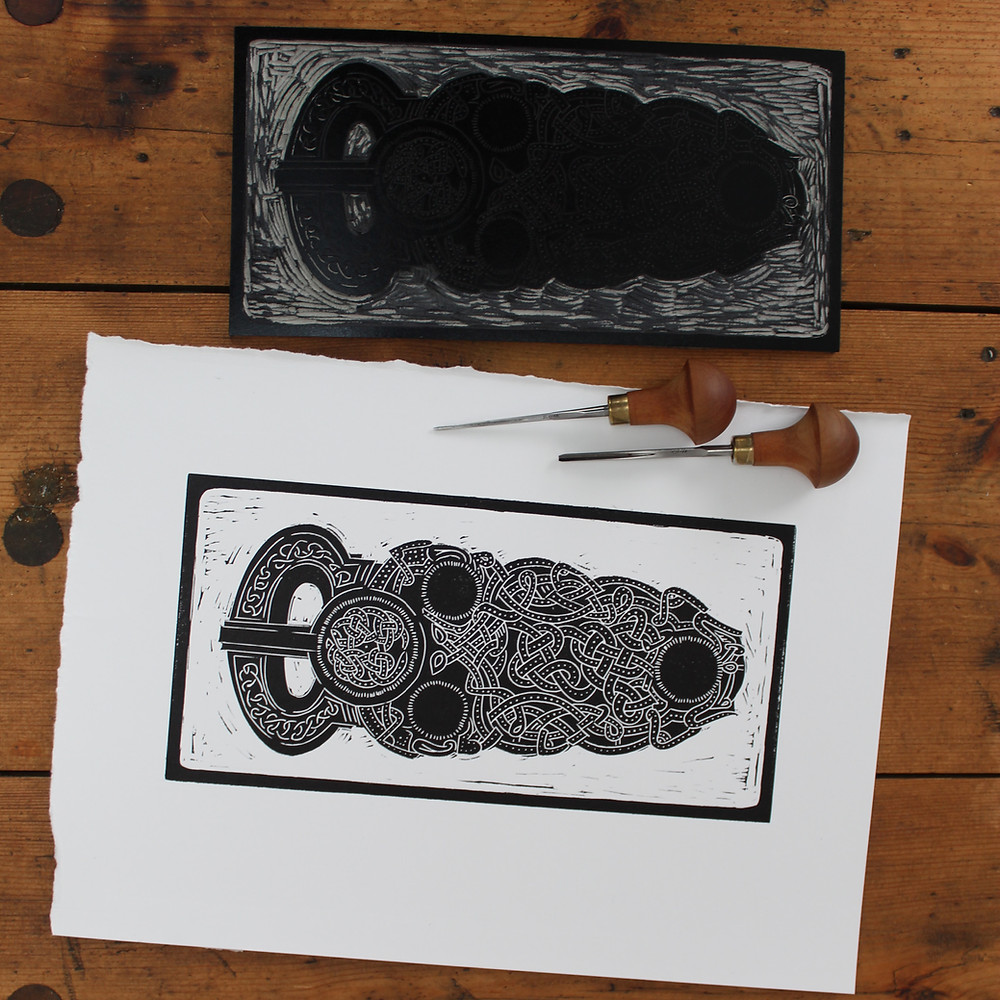 Printed linocut illustration and lino block of the Sutton Hoo Anglo-Saxon gold belt buckle.